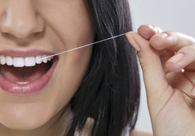 flossing-oral-surgeons-houston-recommend