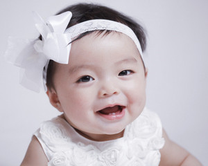 A baby girl happy with her new smile after her cleft palate repair surgery.