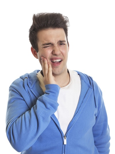 young man with tooth ache considering dental extraction
